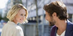 psychology of attraction woman smiling at guy image
