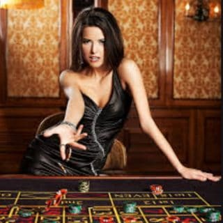 pretty woman rolling dice to illustrate being lucky or good at dating